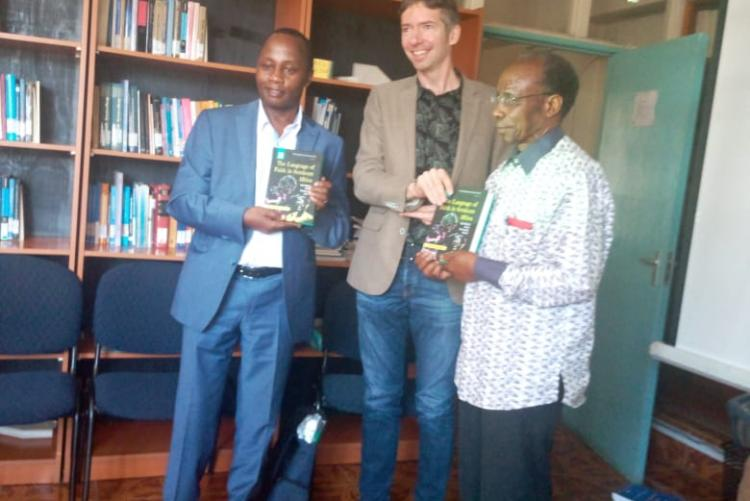Chair and Prof Mugambi with the book