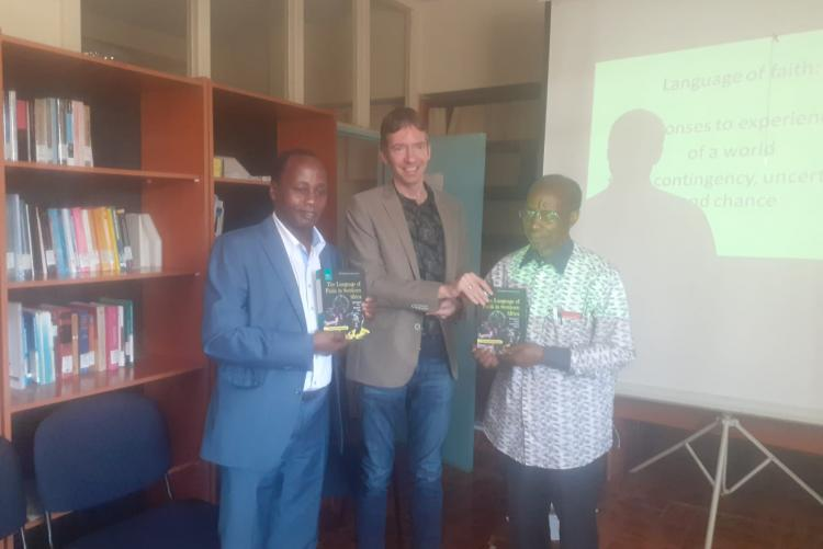 Prof K. Mbugua and JNK Mugambi with the book