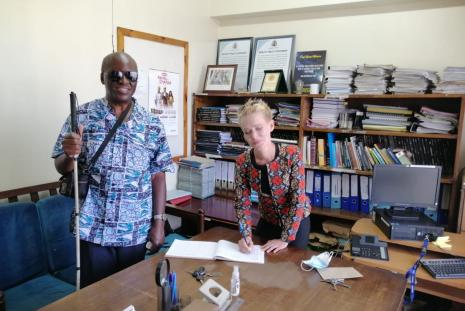 Dr Reginald Oduor (left) , the convener of the talk, and Dr. Dannica Fleuß (right), signing the guest book in the department of Philosophy and Religious Studies